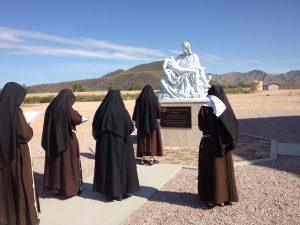 On Holy Saturday the community gathered to pray to Our Lady of Solitude